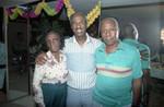 Donald Bohana posing with his parents at his birthday party, Los Angeles, 1989