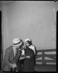Ann Forst sits with an unidentified man at the county jail after being charged with operating a prostitution ring, Los Angeles, 1940