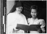 Sister Mary Aquinata, MM, with Legayce de Guzman, Malabon, Philippines, September 25, 1948