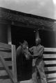 African American man patting a horse in its stall in Autauga County.