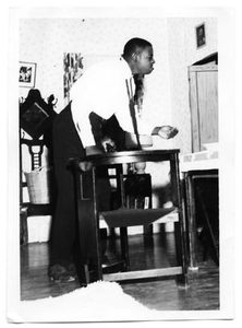 Man Leaning Over Table