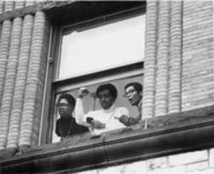 Students at the window of Hopkins Hall during the occupation, 1969