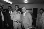 Astronaut Guy Bluford shaking hands during a school visit, Los Angeles, 1985