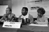 Dr. James Anderson at a press conference with Bo Jackson and his wife, Linda, discussing Jackson's hip injury and rehabilitation at the Alabama Sports Medicine clinic of HealthSouth in Birmingham, Alabama.