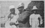 Man flanked by two boys, Haiti