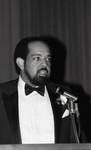 Alpha Kappa Alpha Sorority dance attendee speaking into a microphone, Los Angeles, 1984