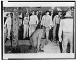 [African American man, rising, after being knocked to the ground by mob at Central High School, Little Rock, Arkansas]