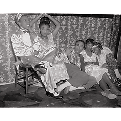 Five people in costume resting