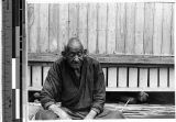 Elderly Japanese man sitting with his eyes closed, Japan, ca. 1947