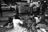 Young civil rights demonstrators lying on a sidewalk after being stopped by police during the Children's Crusade in Birmingham, Alabama.