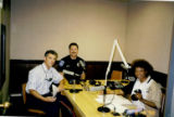 "Photograph of Debbie Conway hosting the radio show ""Economic Empowerment into the 21st Century,"" circa 1998"