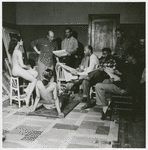 Artist Romare Bearden conducting an art class in his studio with Marvin and Morgan Smith, James Yeargans and Bob Yeargans