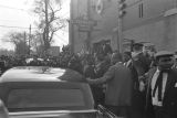 Car stopped beside the crowd in front of Ebenezer Baptist Church at Martin Luther King, Jr.'s funeral.