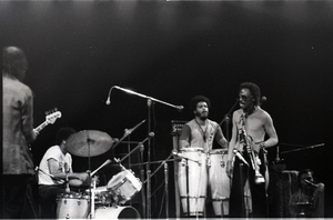 Miles Davis in performance: band with James Mtume (congas) and Miles Davis