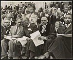 [Seated on speakers' platform at May 17 Prayer Pilgrimage for Freedom in Washington, D.C. (left to right): Roy Wilkins, A. Philip Randolph, Rev. Thomas Kilgore, Jr., and Martin Luther King, Jr.]