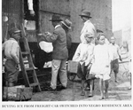 Buying ice from freight car switched into Negro residence area