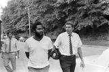 Lieutenant Doug Acker escorting Anthony Ray Hinton to the city jail in Bessemer, Alabama.