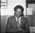 African American automobile salesman posing for a portrait, Los Angeles, 1971