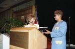 Iris Rideau presenting a book to Evelina Williams, Los Angeles, 1992