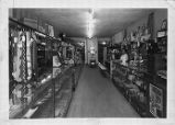 Interior view of Rhythm Records and Sporting Goods with Leroy Smith behind the counter.