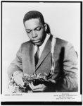 [John Coltrane, half-length portrait, facing left, holding saxophone]