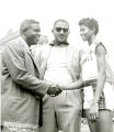 Jackie Robinson and Don Newcombe of the Brooklyn Dodgers congratulate Wilma Rudolph at the Penn Relays