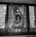 Damaged stained glass window inside 16th Street Baptist Church in Birmingham, Alabama, after the building was bombed.