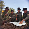 Soldiers reading a map during a military exercise at the U.S. Army training facility at Fort McClellan near Anniston, Alabama.