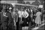 """[Marchers arriving by bus, with """"CORE Downtown"""" sign, at the March on Washington, 1963]"""