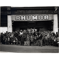 Children and the theatre owners in front of the Rhumba Theatre on Fullerton Street