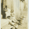 Young black sisters on a porch in Tennessee
