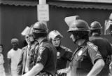 Police officers and protestors at a United Klans of America march in Mobile, Alabama.
