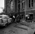 Damaged car and debris beside 16th Street Baptist Church in Birmingham, Alabama, after the building was bombed.