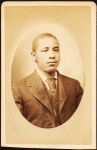 Studio portrait of a young man wearing tie and stick pin