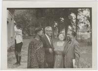 Group (left to right) Godwin Mbadiwe Ewelaku, Dr. Horace Mann Bond, Rosey Pool, Langston Hughes, outside Randdek Hall, Lagos, Nigeria