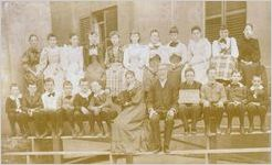 A black and white image of the Massie School Seventh Grade class, late 1800s (Principal J. E. Way)