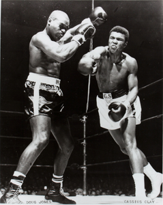 Doug Jones and Muhammad Ali (Cassius Clay) sparring in ring