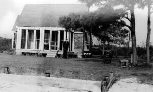 Jackson Davis's cottage. Unidentified man