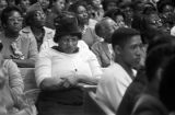 Audience in a church building, probably listening to Martin Luther King, Jr., speak.