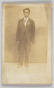 Photographic postcard of a man in a suit