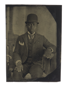 Tintype of man in suit, tie, and hat