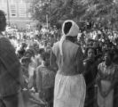 Dorothy Frazier addressing a crowd from the stoop of a brick building at Alabama State College in Montgomery, Alabama, during a student demonstration.