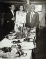 Smiths and their Grandson Roger Beasley stand at holiday table