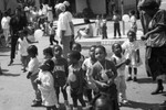 Child Development Center children and adults looking up at balloons, Los Angeles, 1987