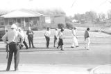 Willie Kolb, James Kolb, and others, walking down a street during a civil rights demonstration in Luverne, Alabama.