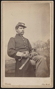 [Lieutenant Joseph B. Abbott, Jr., of 137th New York Infantry Regiment in uniform with sword in front of painted backdrop]