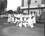 Group photograph of members of the Order of the Eastern Star standing in front of Orange Valley Lodge #13