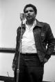 James Forman speaking during a meeting in the Tuskegee Institute gymnasium, which was held to discuss student demonstrations protesting the murder of Samuel L. Younge.