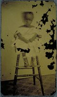 African-American child in a highchair, Norwich