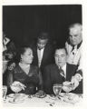 Richard J. Daley and an African American woman at a banquet
